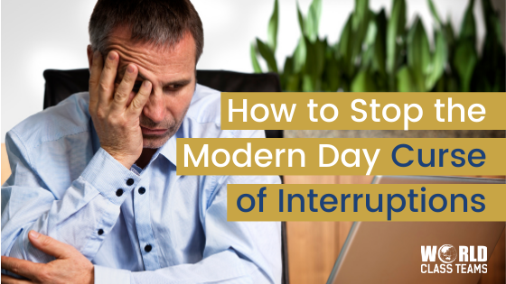 Man in office looking frustrated - how to stop the modern day curse of interruptions